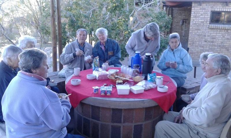 Kalahari tour group enjoying breakfast